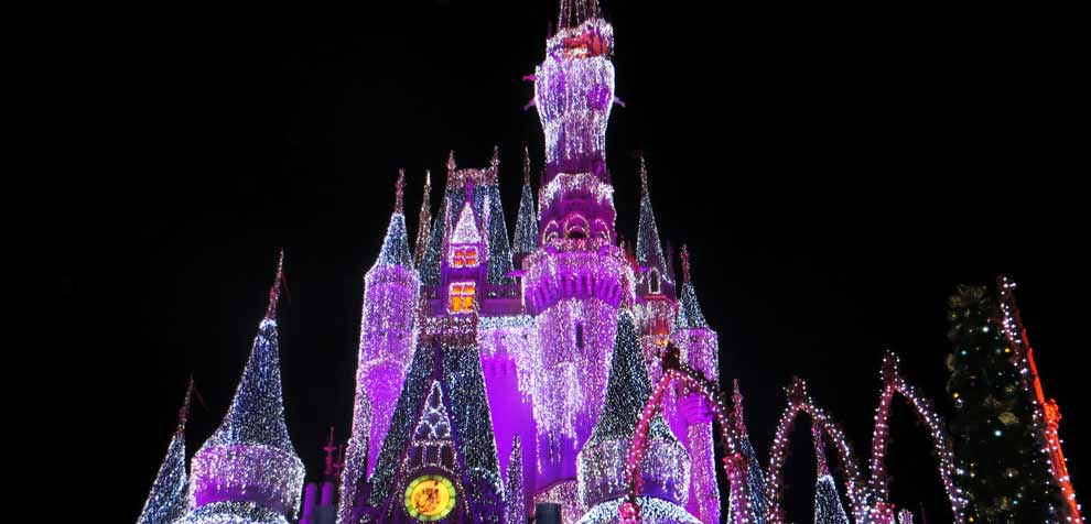 Photo by Magda Ehlers from Pexels https://www.pexels.com/photo/pink-white-and-purple-light-up-disneyland-castle-771502/
